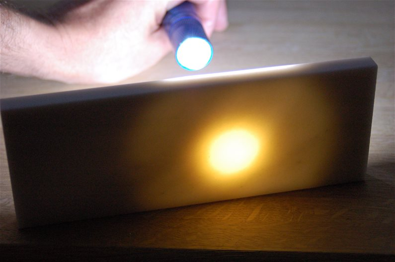 Hard Translucent Arkansas Stone Sharpening showing Translucence with Flashlight